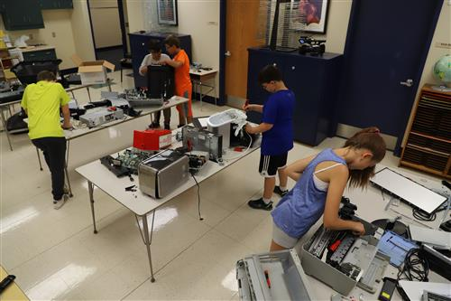 This is an image of students working on electronics in a summer school lab.