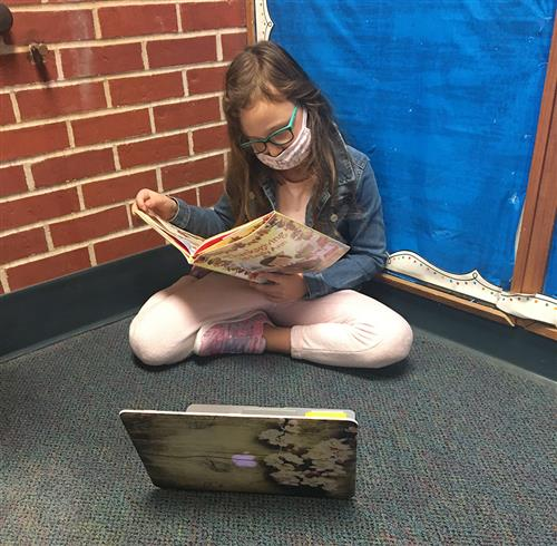 a student reading a book.
