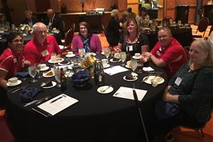 This is a photo of Ralston Board of Education Members sitting at a table at the NASB meeting