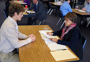 This is an image of a student and business leader participating in a mock-interview.
