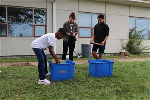 This is an image of Ralston Middle School students testing their homemade bricks.