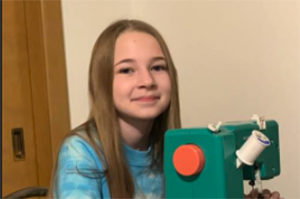 Seymour Elementary student pictured with her sewing machine.